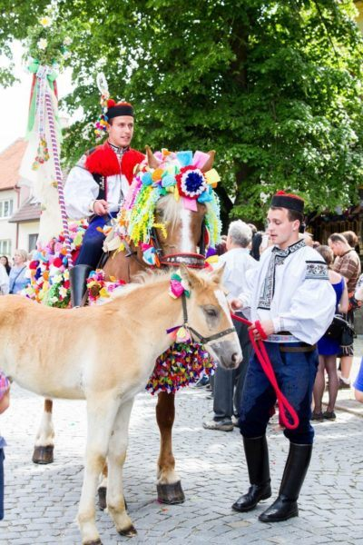 The kings guards are mounting their steeds for the Ride of the Kings in Vlčnov, Czech Republic.