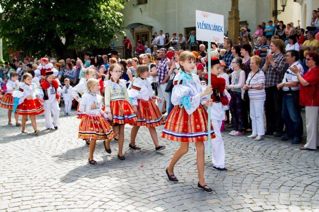Girls marching in traditional folk dress in Czechia.