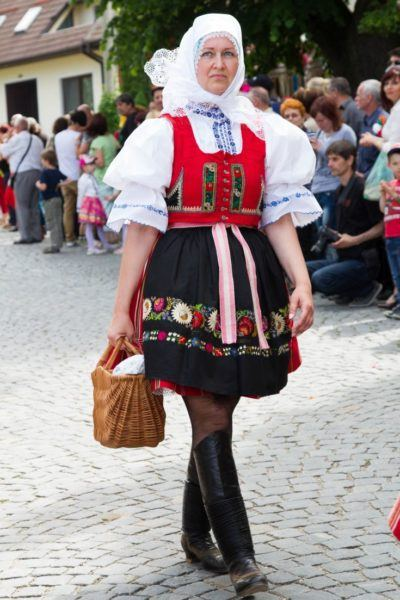 Woman in traditional Czech red and black dress with emroidered flowers.