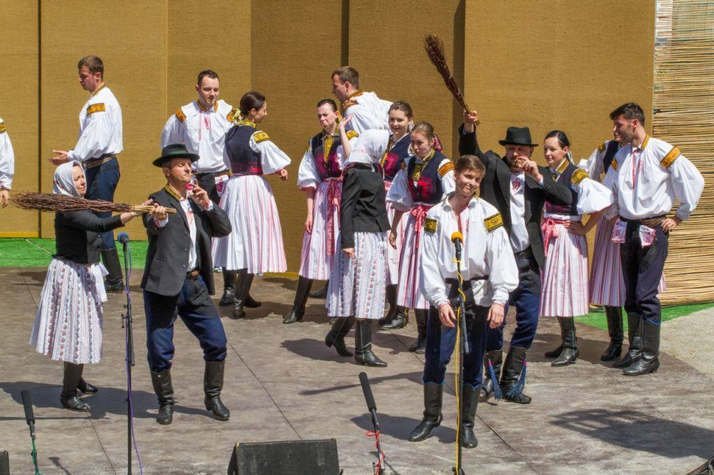Czech folk dancers on the stage during the Ride of the Kings  in Czechia.