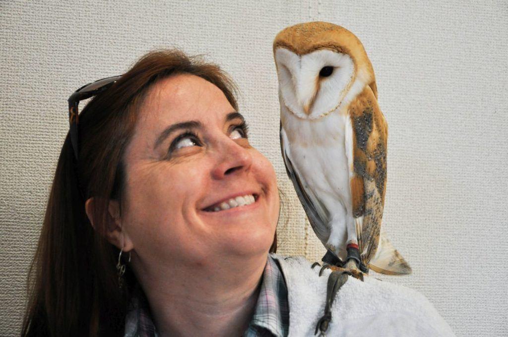 Owl perched on Ernestine's shoulder.