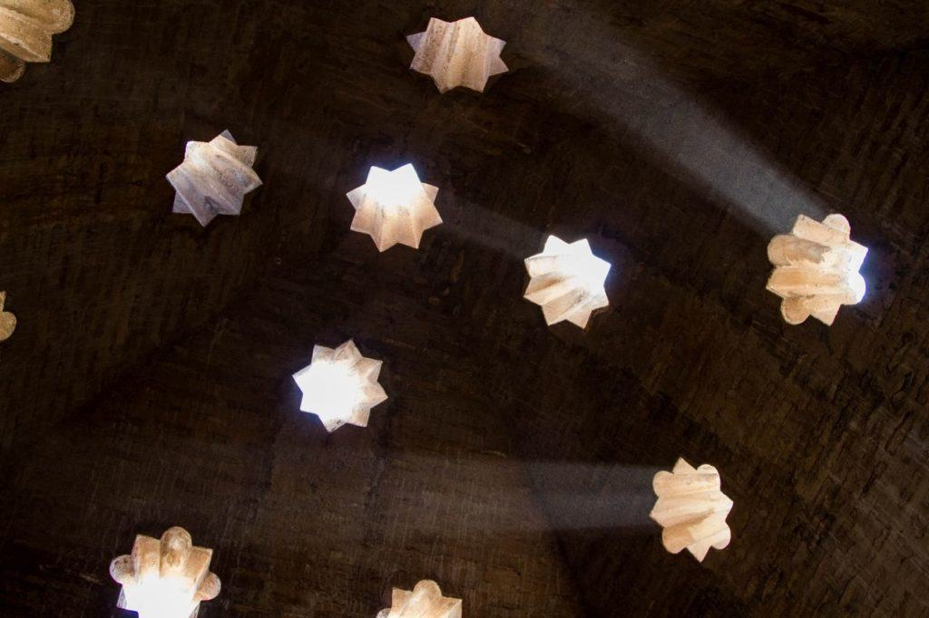 In the old bath, star shaped light shines through.