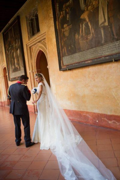 A beautiful bride and groom were having a photo shoot in the monastery.