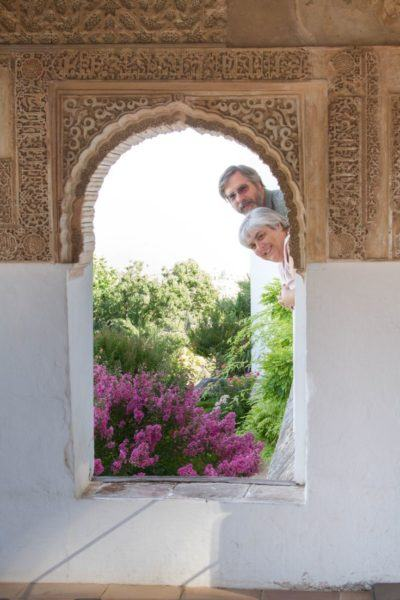 Peeking through an arched window in the Alhambra.