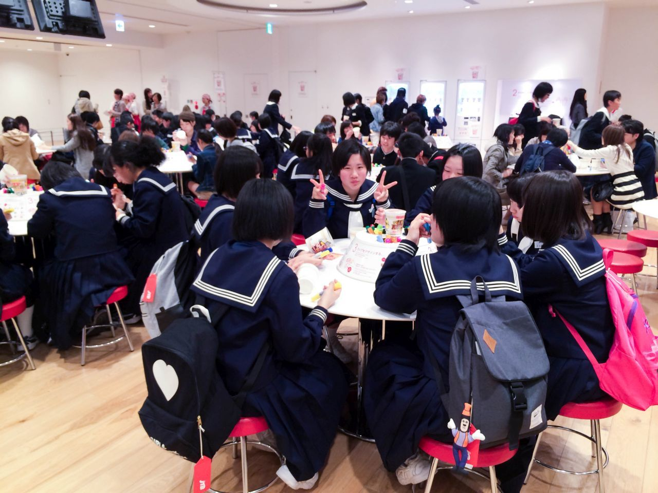School children designing cups at the Cup Noodle Factory