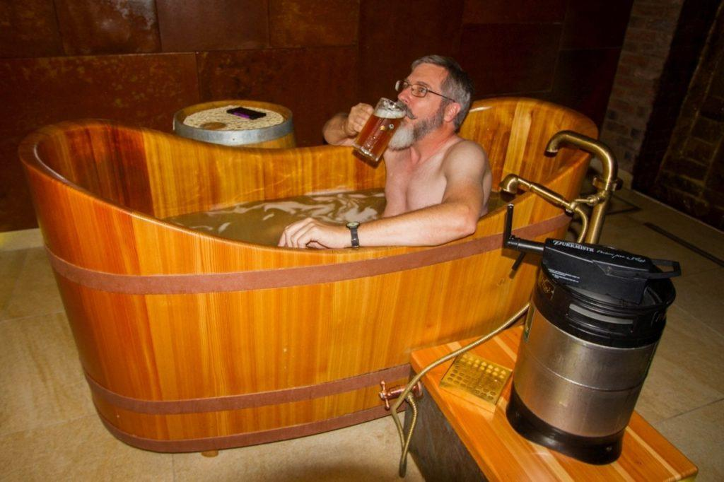 Jim drinking a pils in the beer bath