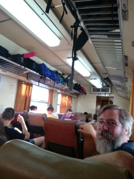 Jim sitting on the train during our train travel in Eastern Europe.