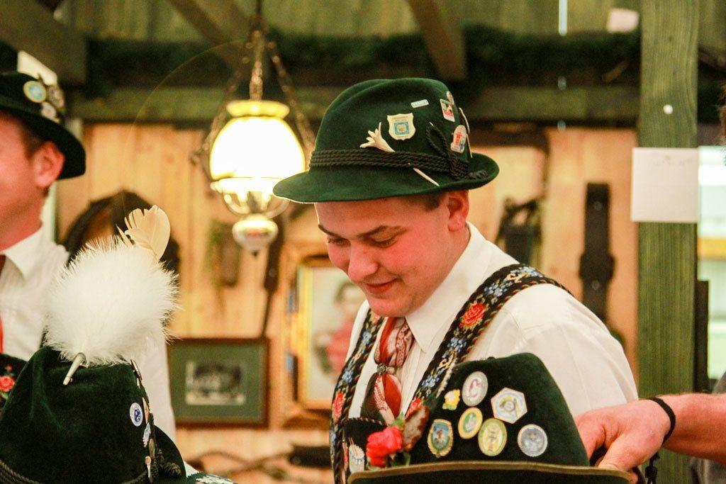 Green hats with medallions and feathers are part of the band's wardrobe.