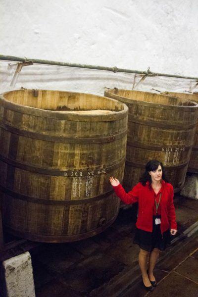 Wooden barrels filled with Pilsener Urquell beer.