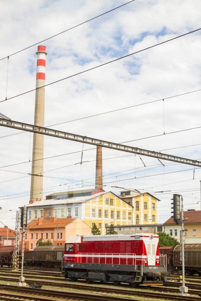 Red train car in a rail yard in Eastern Europe