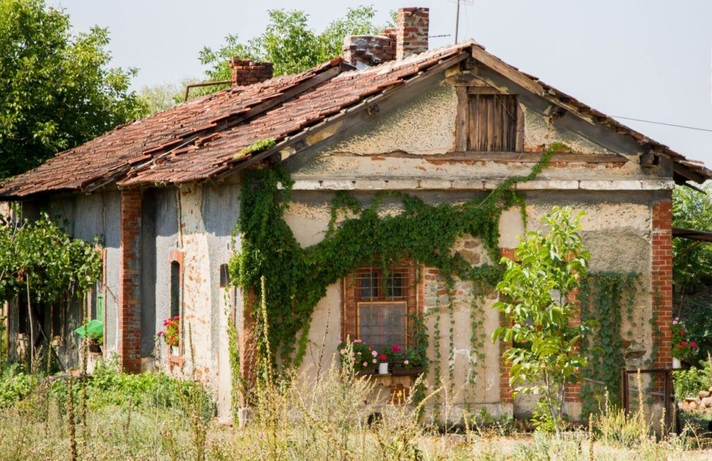 A Serbian house next to the railroad tracks during our train travel in Eastern Europe.