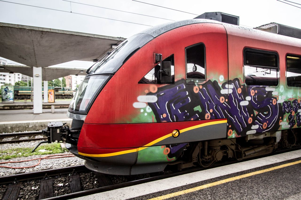 Red Train with graffiti on our Eastern Europe train itinerary