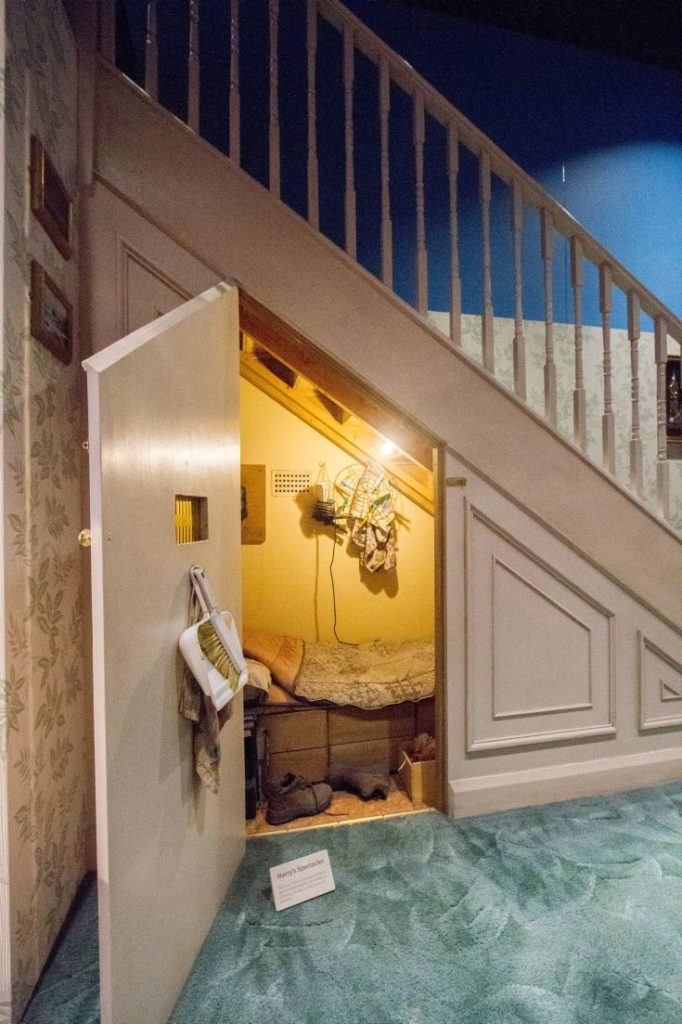 Harry's bed under the stairs.