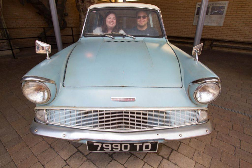 Erika and Michael Sitting in the famous Weasley flying blue car.