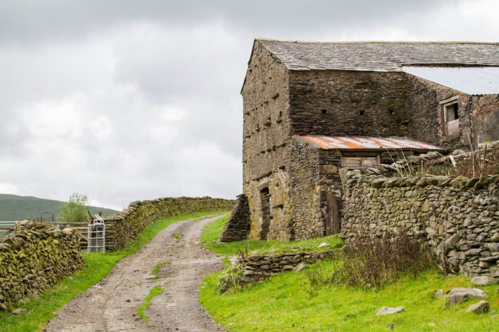 Scenic old stone farm building on a Lake District backroad.