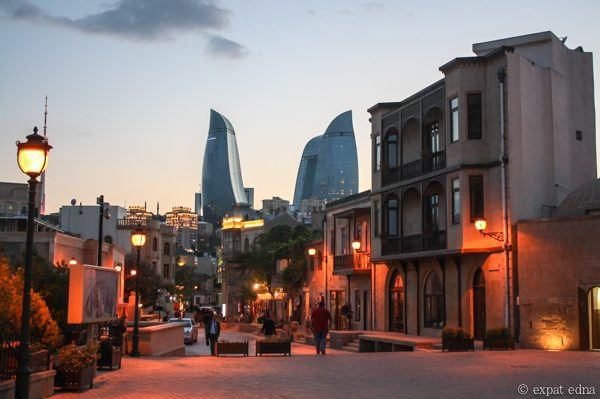 Old and new buildings in Azerbaijan at sunset.