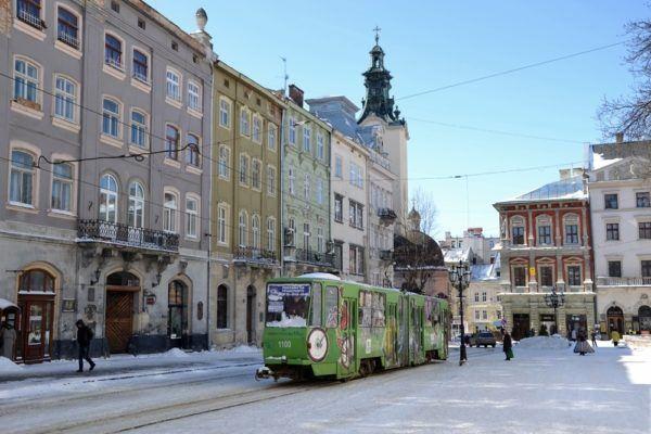 Green street car on a snowy day in Lviv, Ukraine.