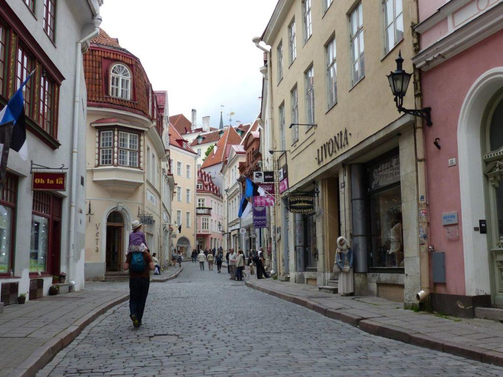 Tallinn old town street with shops and cobblestones.