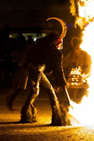 Krampus playing with fire.
