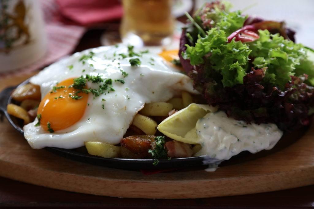 This hearty dish is a Bauernschnitzel or Farmer's Schnitzel.