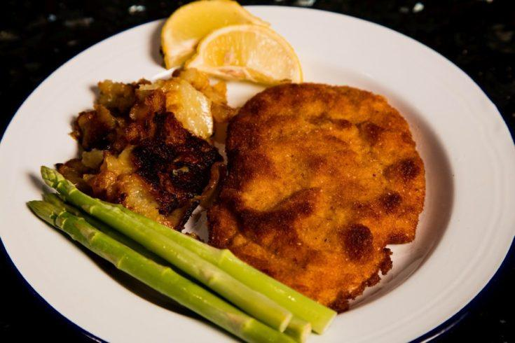 Finished and plated schnitzel