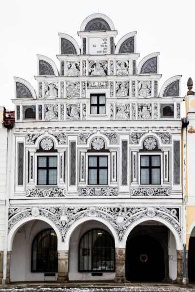 Ornately decorated building facade in Telc, Czechia.
