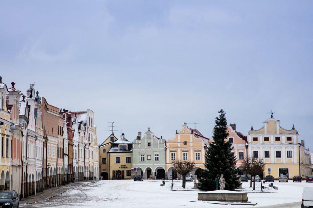 Triangular market square in Telc with Baroque and Renaissance building facades.