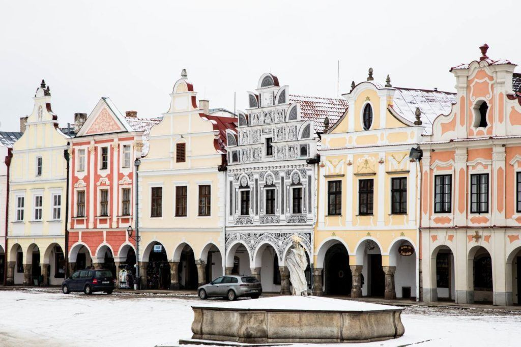 Historic center of Telc, Czechia, fountain with angel statue and Baroque buildings in background.