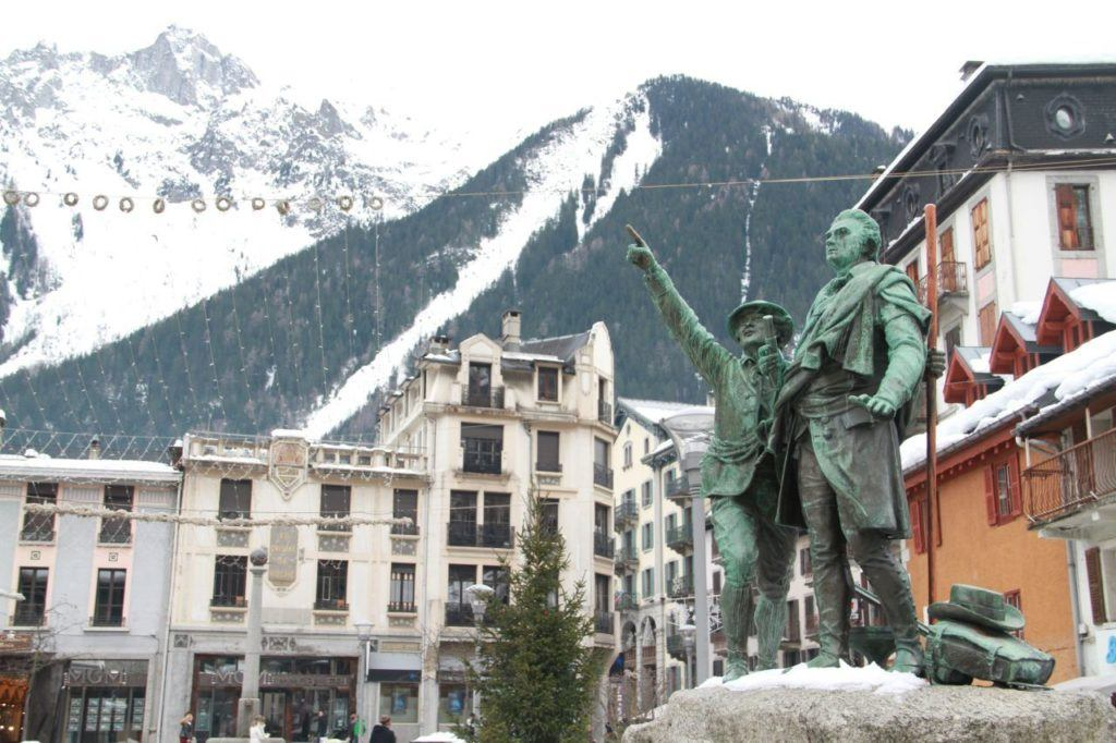 Statue of Balmat and Saussure in the center of picturesque Chamonix ski village.