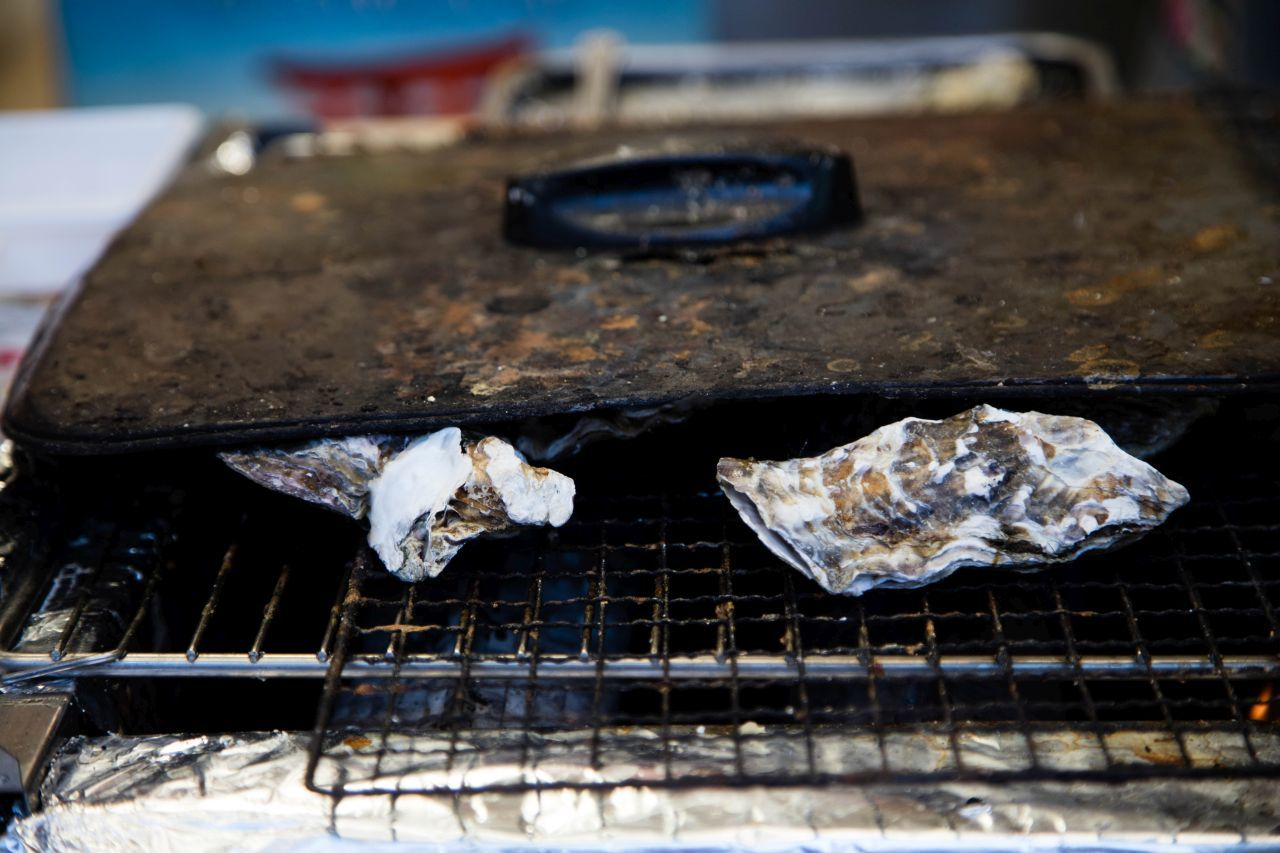 2 oysters being grilled, Make sure to add oysters to your Japan food guide.