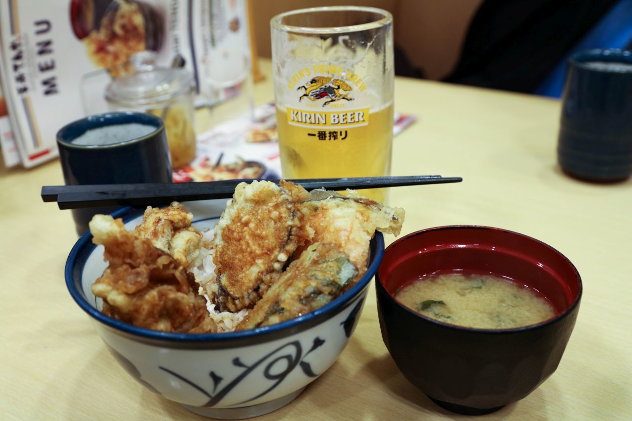 Tempura bowl, one of the most popular Japanese foods, along with Kirin beer and misu soup.