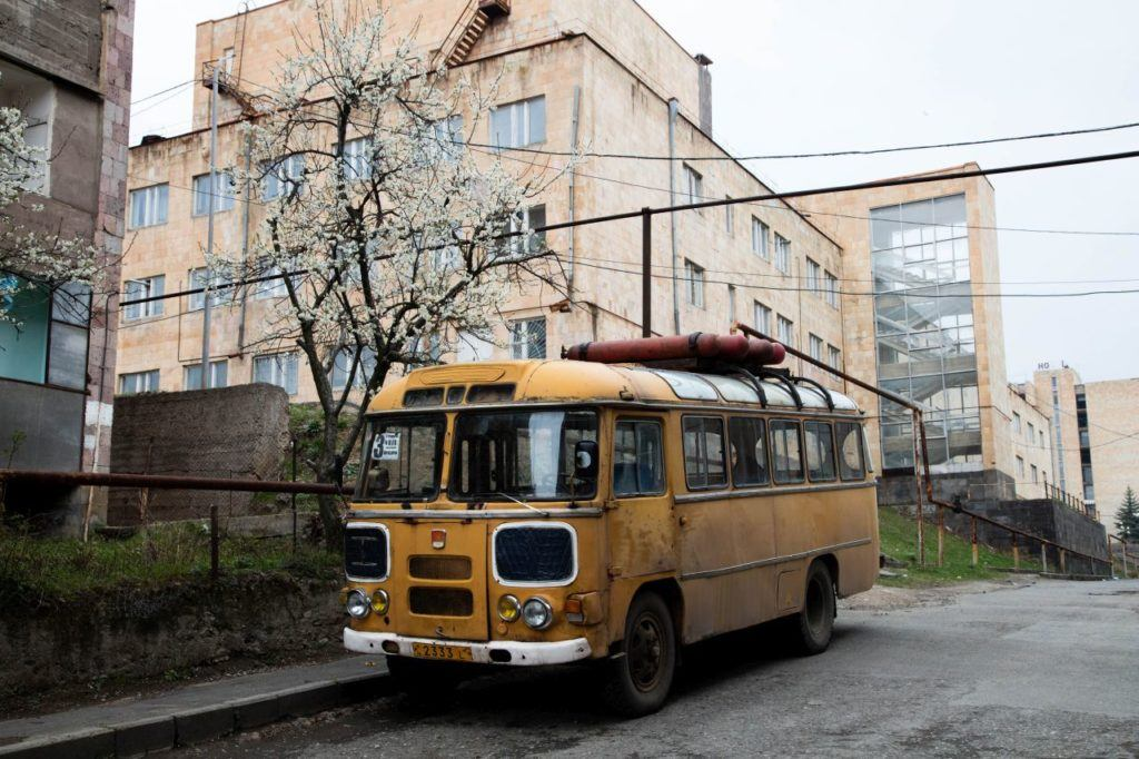 Dilapidated bus and buildings.
