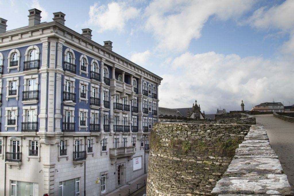 A beautiful blue and white building from on top of the roman wall at Lugo.