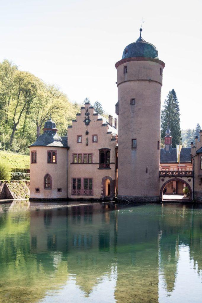 The beautiful turret and water surrounding Mespelbrunn Castle.