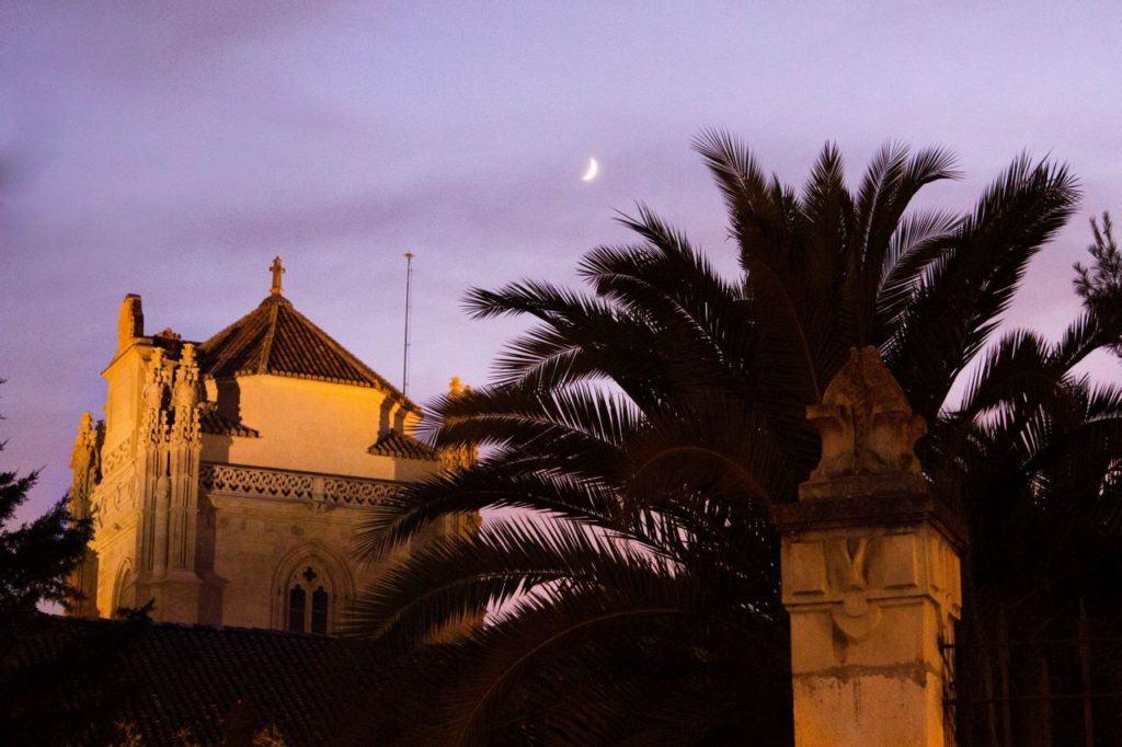 Sunset colors the sky purple in Granada.