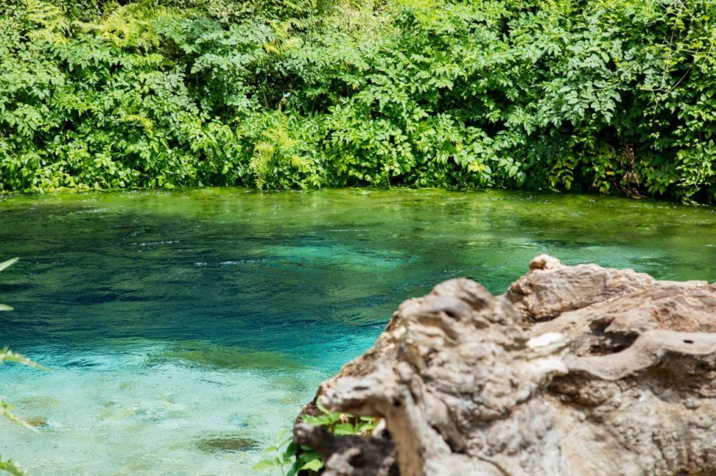 The gorgeous blue water of the Blue Eye in Albania - must-see part of any Albania road trip itinerary.