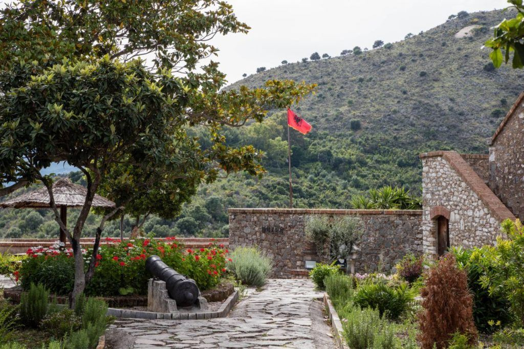 The Albania flag flies proudly over the Butrint ruins.