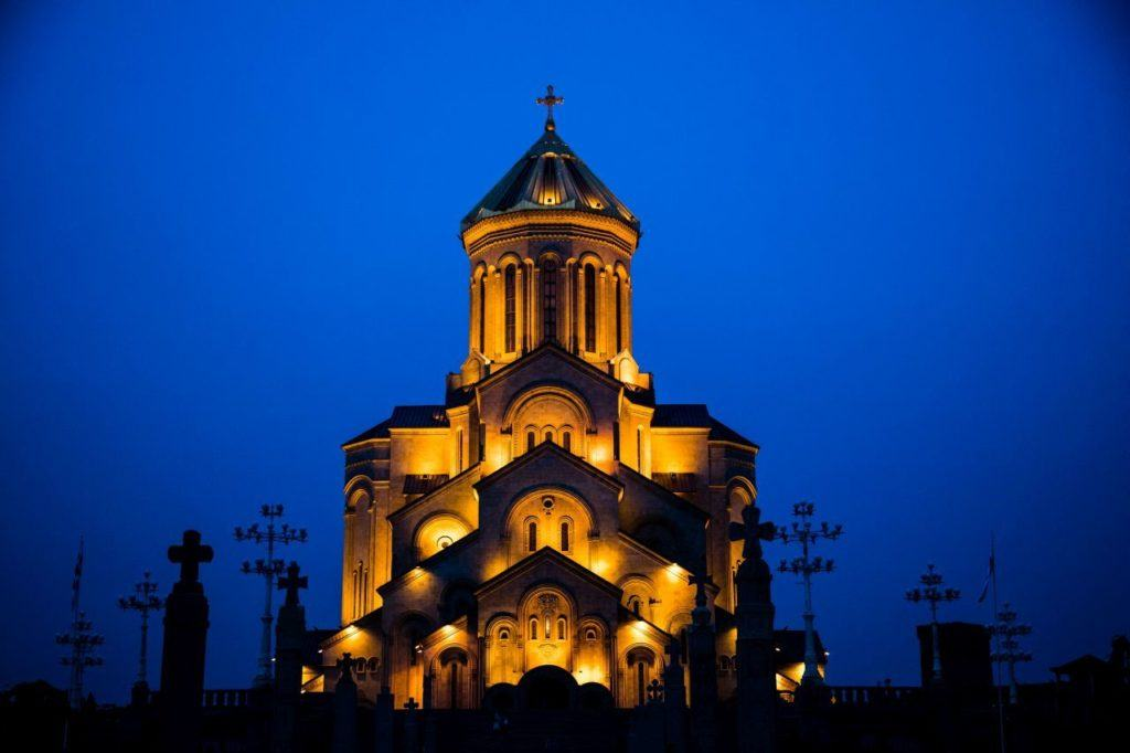 Tbilisi Holy Trinity Cathedral glowing in the evening light.