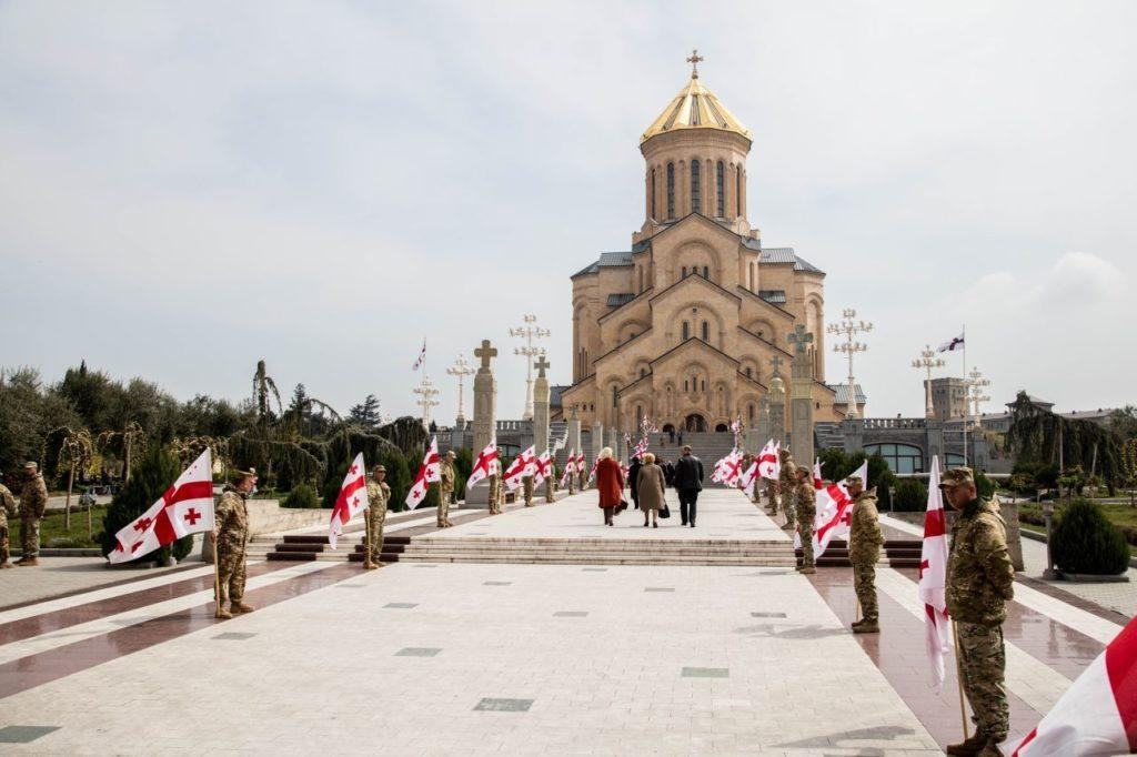 Georgian soldiers honor fallen comrades during memorial ceremony at Holy Trinity Cathedral.
