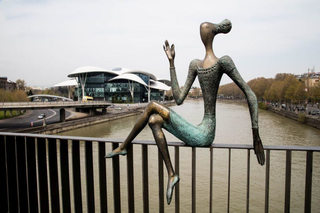 Modern art statue on a bridge in Tbilisi.