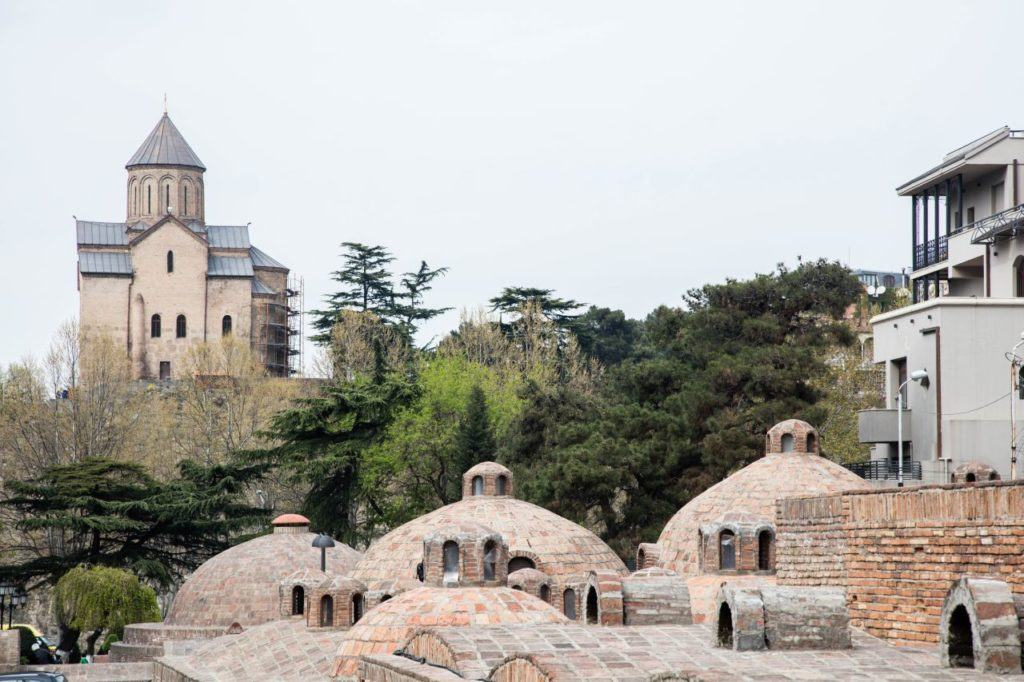 Tbilisi's brick domed bath houses with cathedral in the background.