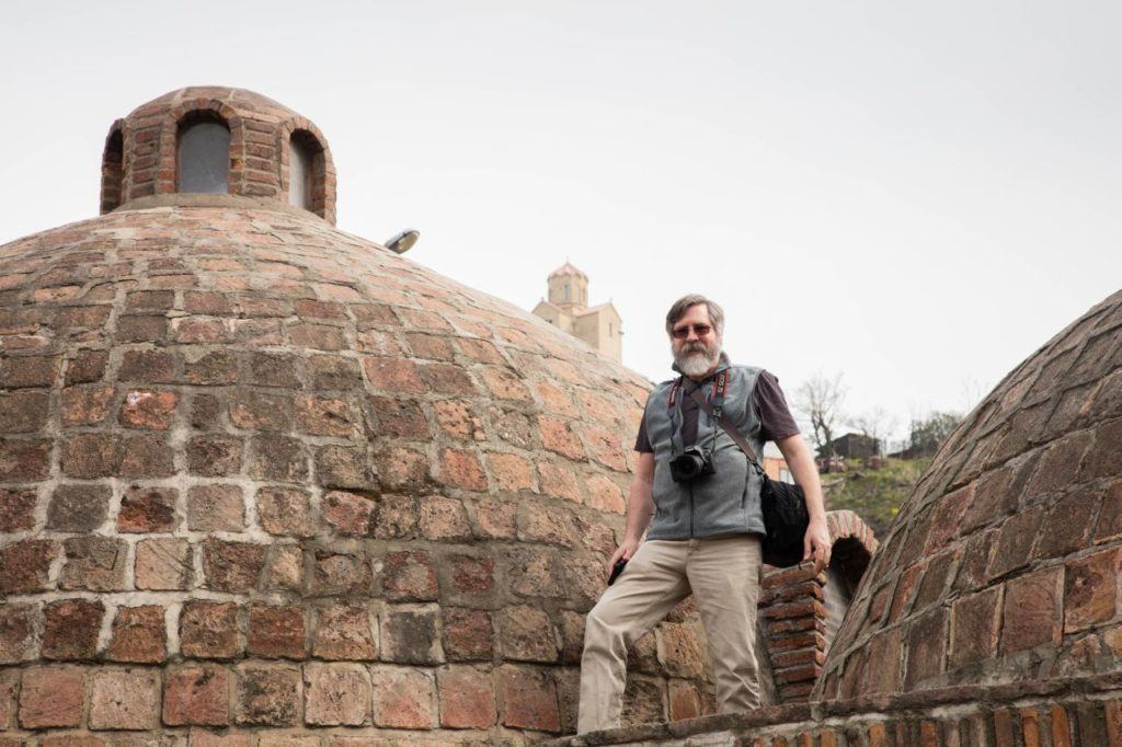Jim walking on the roofs of the sulfur spring baths in Tbilisi.