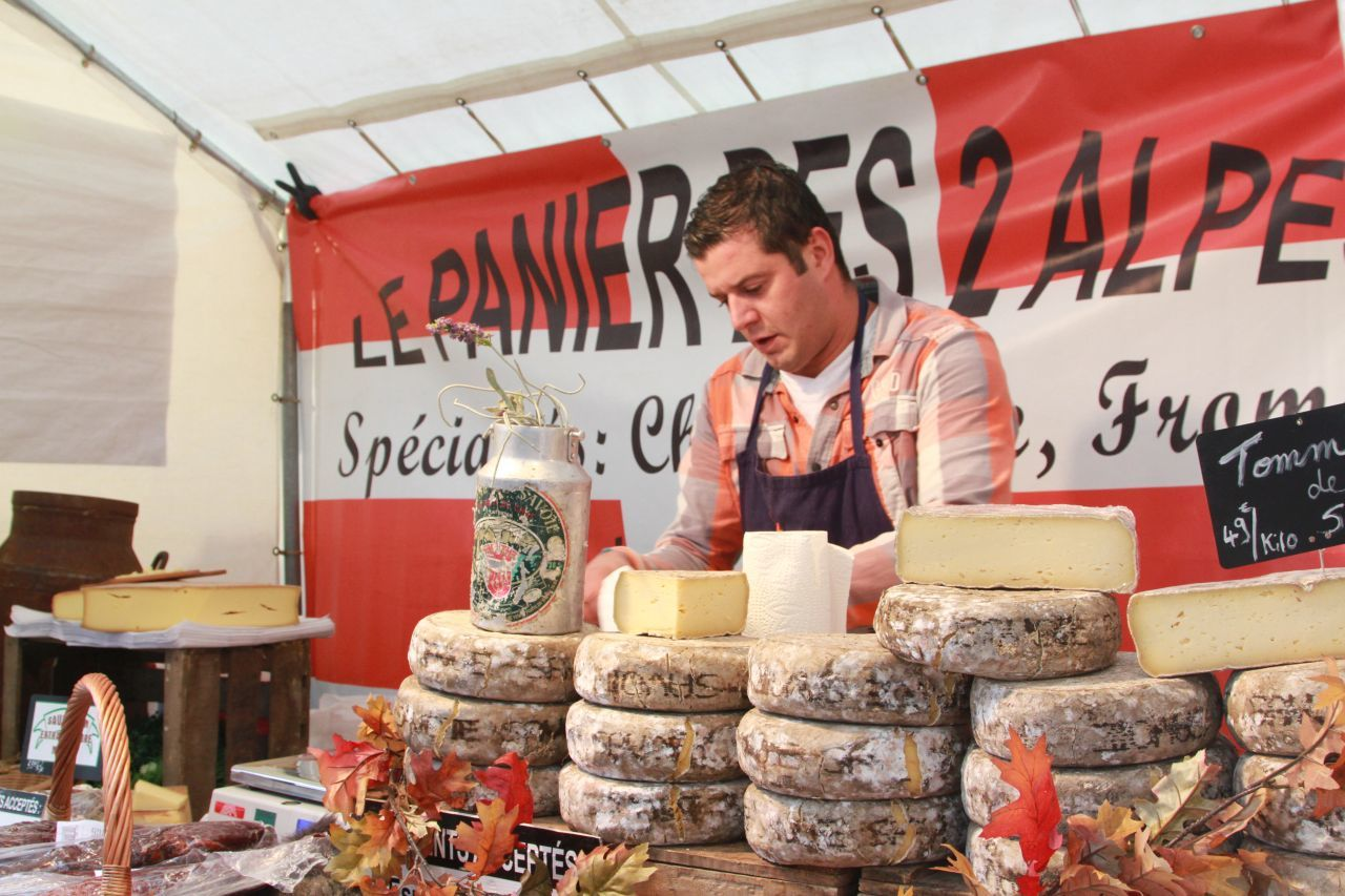 A cheesemonger at a street festival in Montmartre.