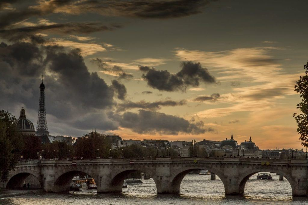 Bridge over the Seine River with the Eiffel Tower in the background.