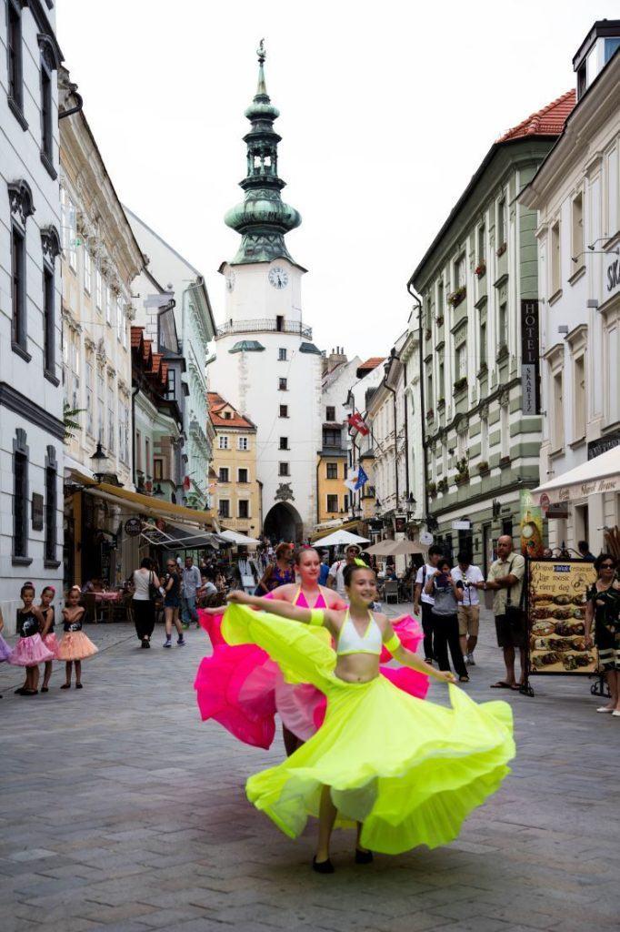 Colorful dancers in the pedestrian streets of Bratislava.