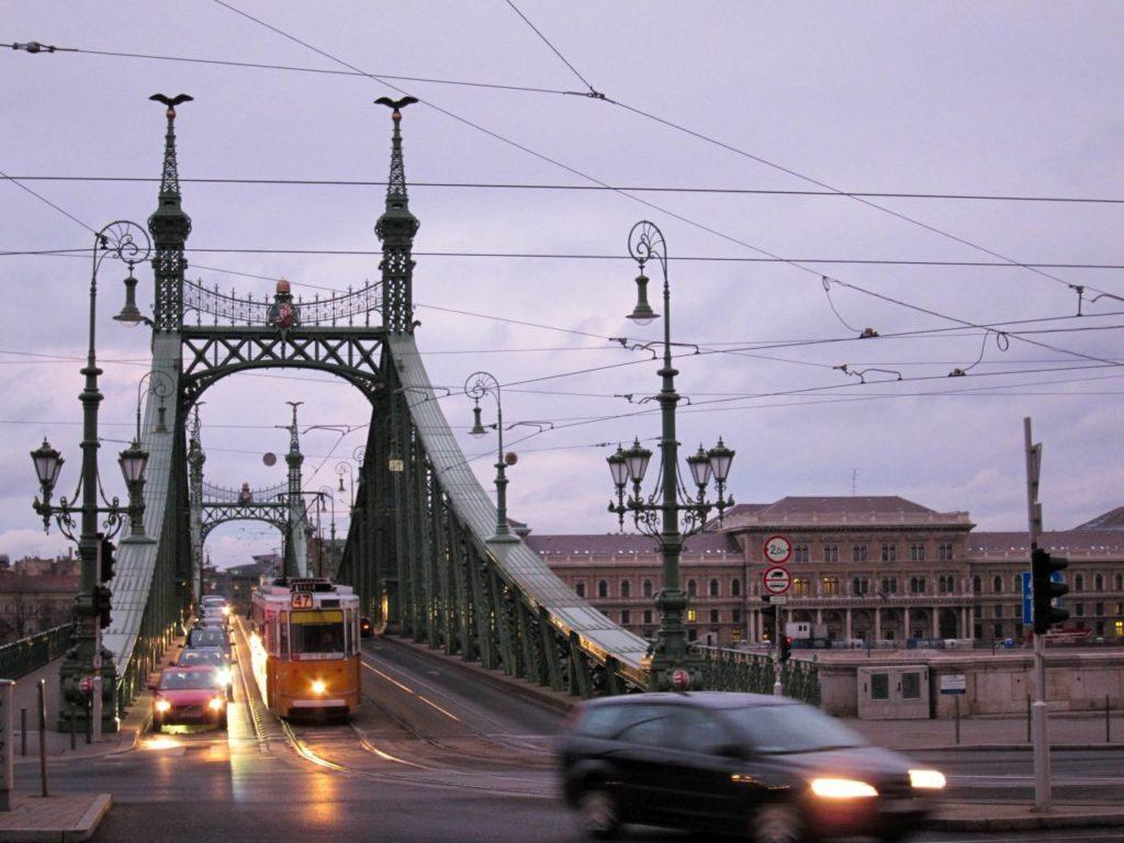 Tram and cars crossing the Danube in Budapest