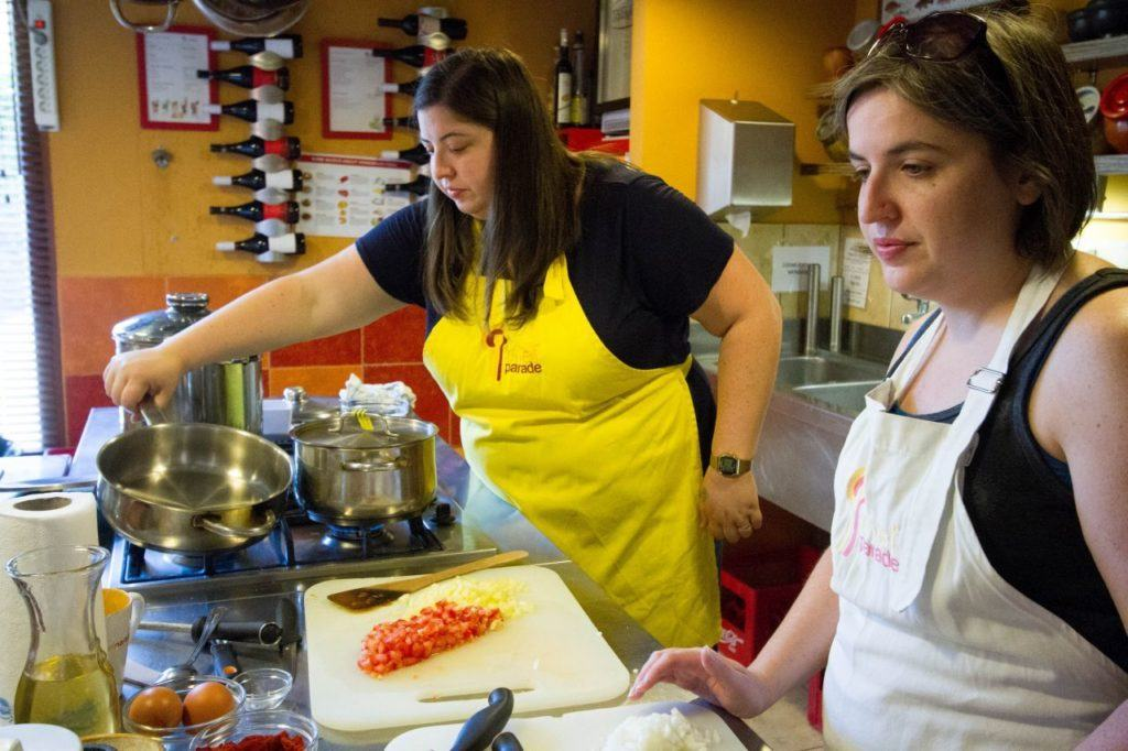 """Devon and Erika """"learning to cook"""" at Chef's Parade in Budapest."""