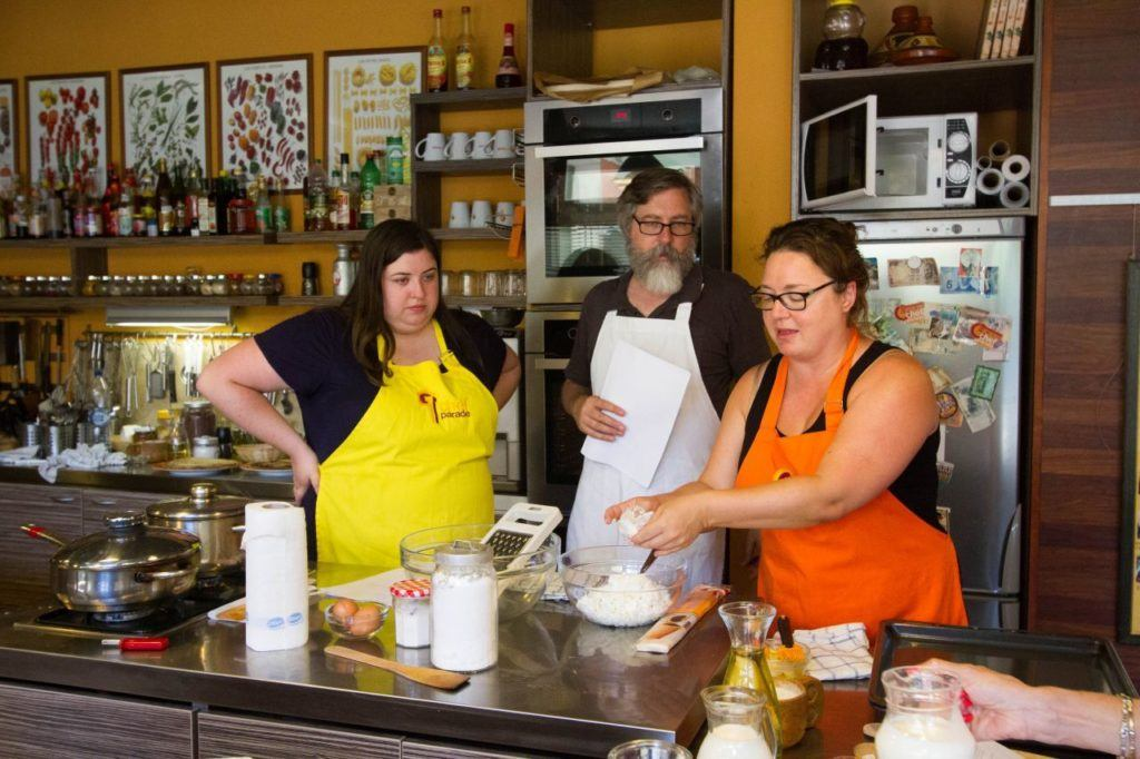 Anna shows Jim and Erika the finer points of mixing the spaetzle batter.