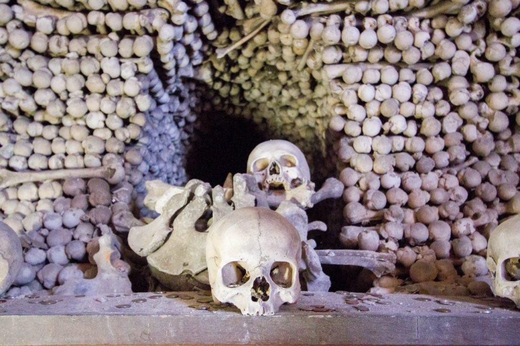 Piles of human bones and skulls in the Sedlec Bone Church a ghostly destination in Kutna Hora.