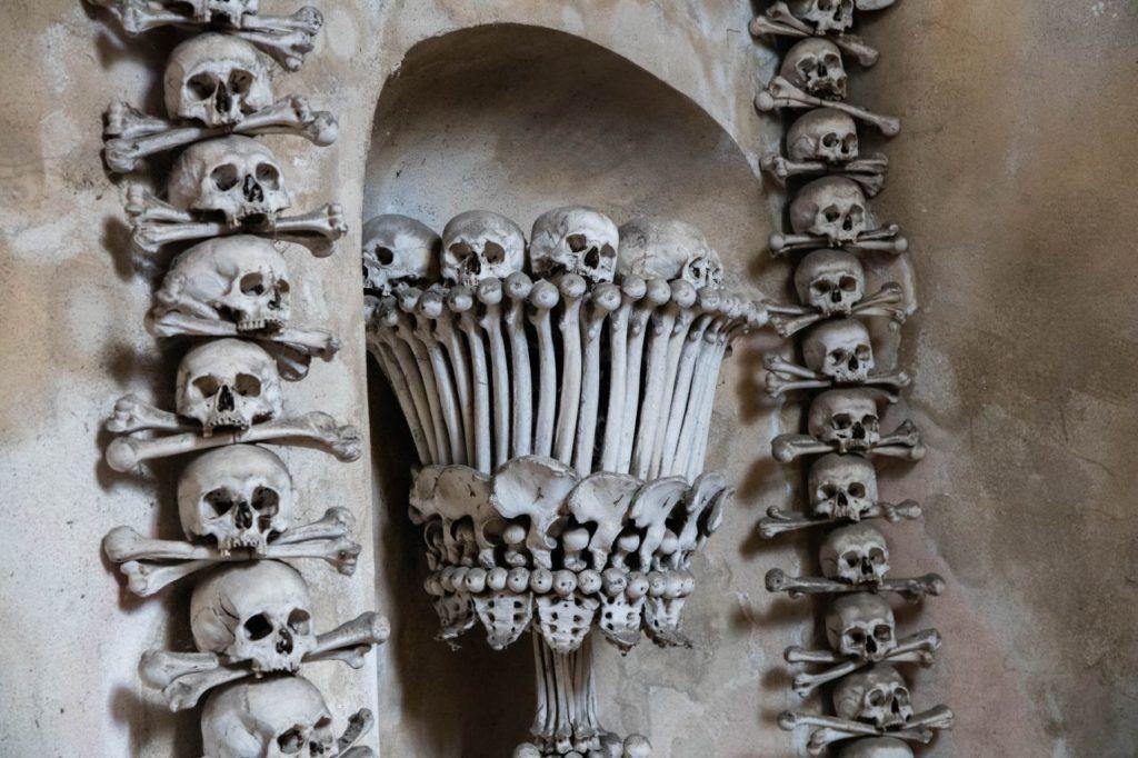 Closeup of human skulls and bones decorating the interior of Sedlec bone church.
